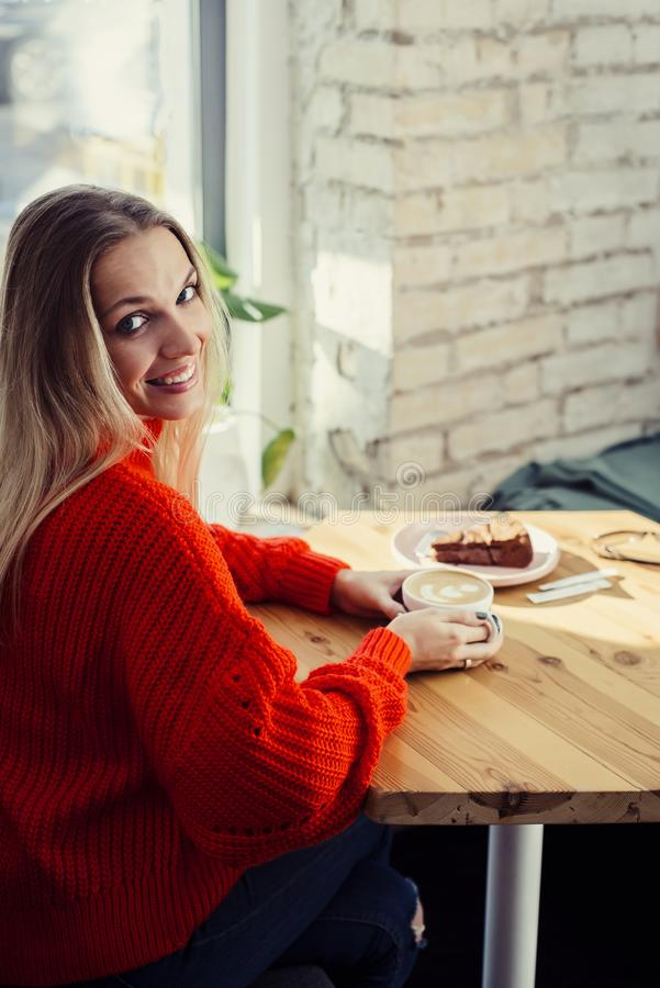 Happy woman enjoying some coffee in a restaurant stock photos