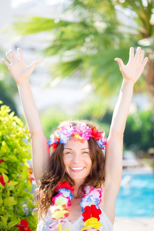 Happy woman enjoying sun on the beach stock photography