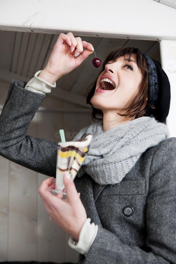 Download Happy Woman Enjoying Sweet stock photo. Image of scarf - 17804740