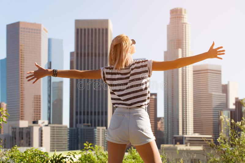 Happy woman enjoying the view Los Angeles downtown, California, USA royalty free stock images