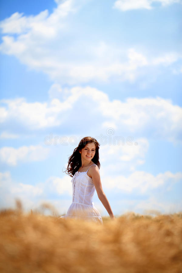 Happy woman enjoying in wheat field royalty free stock photo