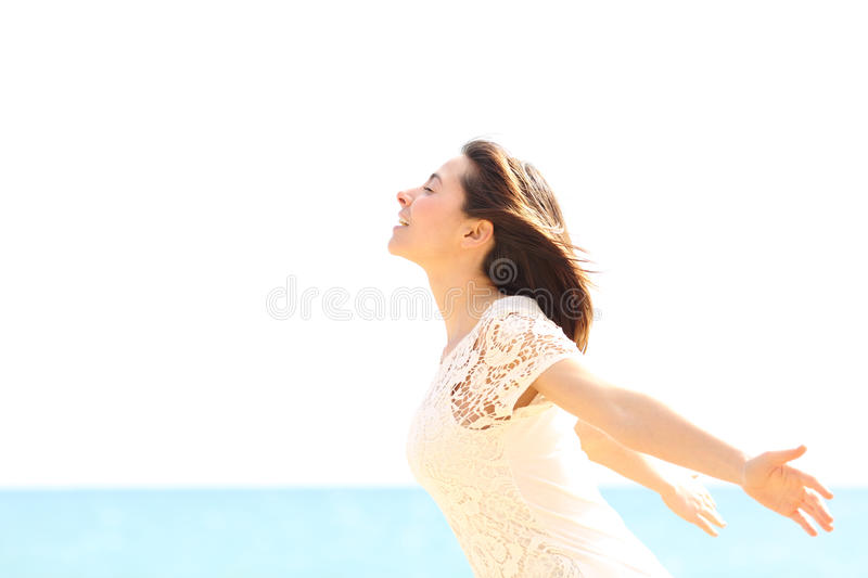 Happy woman enjoying the wind and breathing fresh air stock photo