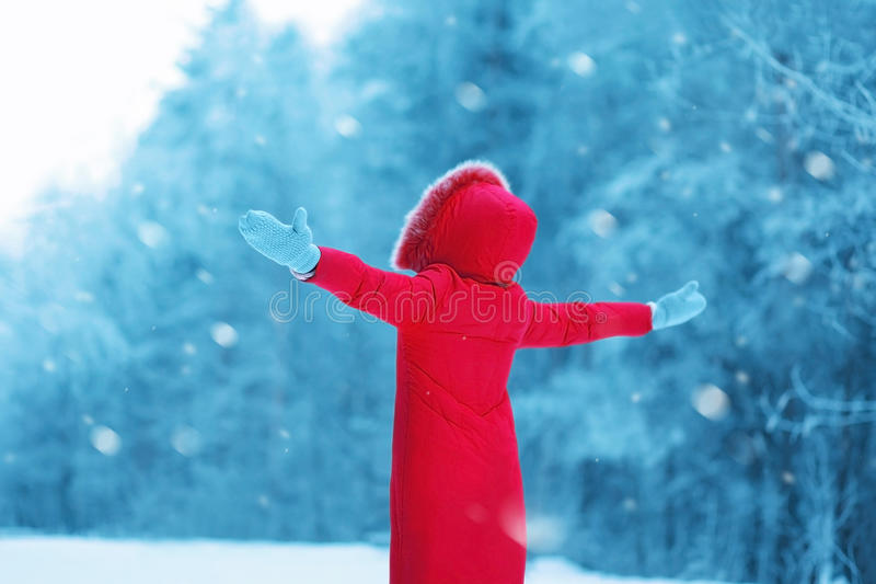Happy woman enjoying winter snowy weather outdoors, season. Is open stock photos