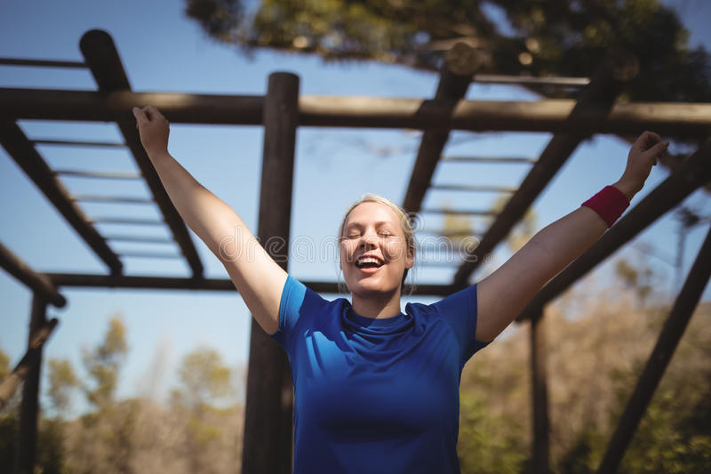 Happy woman exercising during obstacle course stock photos