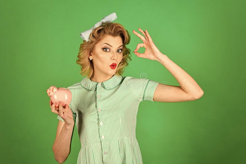 Happy woman. family budget, bankruptcy and handout. Family budget, pinup housewife save money with ok gesture royalty free stock photos