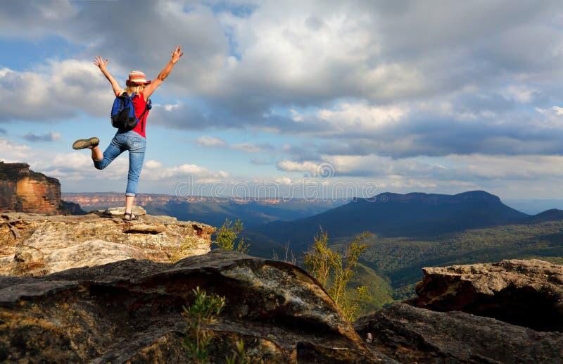 Happy Woman feeling elation, joy, success, accomplishment. Happy female hiker, traveller, feeling, elation, joy, success, or other positive mood or feeling of stock photo