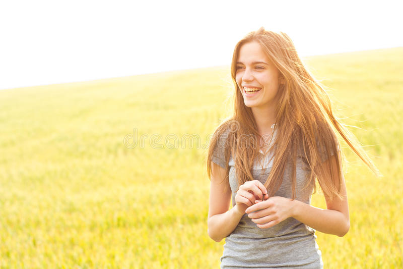 Happy woman in field royalty free stock photo