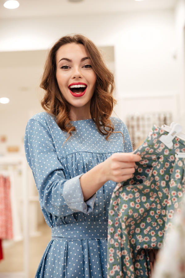 Happy woman find cool pants stock photo
