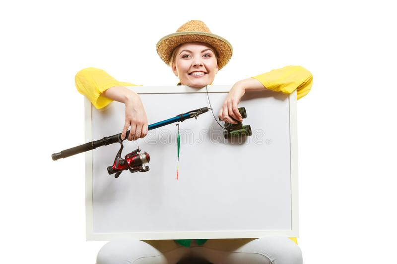 Happy woman with fishing rod holding board royalty free stock photos