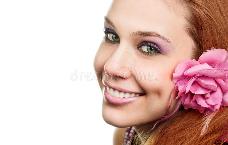 Happy woman with flower at ear isolated on white. Background stock images