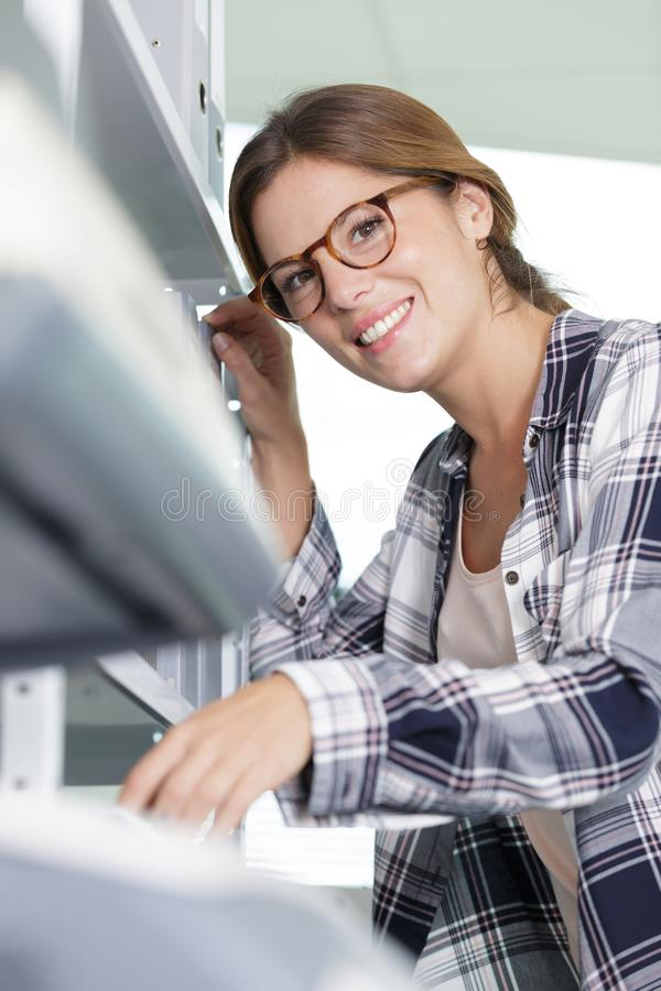 Happy  woman with folders looking at camera. Woman stock photography