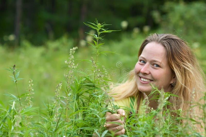 Happy woman with fresh hemp royalty free stock photos