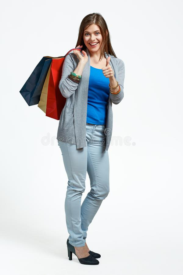 Happy woman full body portrait with shopping bag. On studio background stock photography