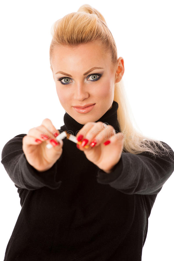 Happy woman gesturing quitting stinky unhealhy habbit by breaking cigarette decided to quit smoking. stock photo