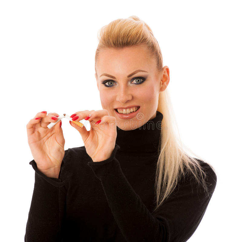 Happy woman gesturing quitting stinky unhealhy habbit by breaking cigarette decided to quit smoking. royalty free stock image
