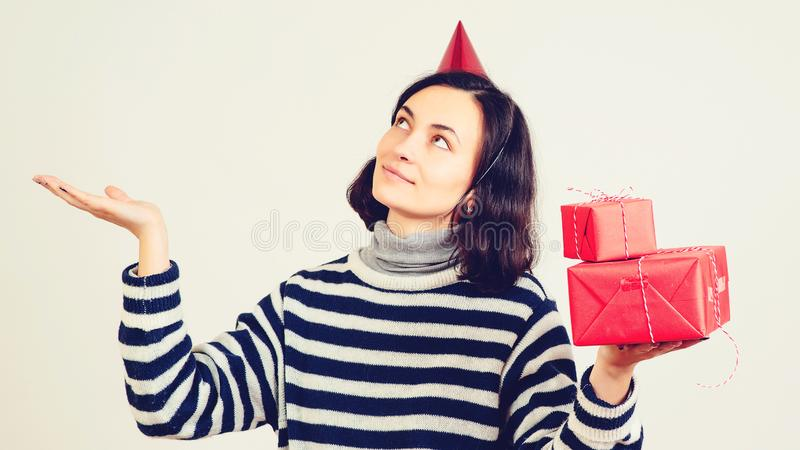 Happy woman with gift boxes at celebration party. Birthday or New Year eve, Christmas party celebrating concept, copy space. stock photo