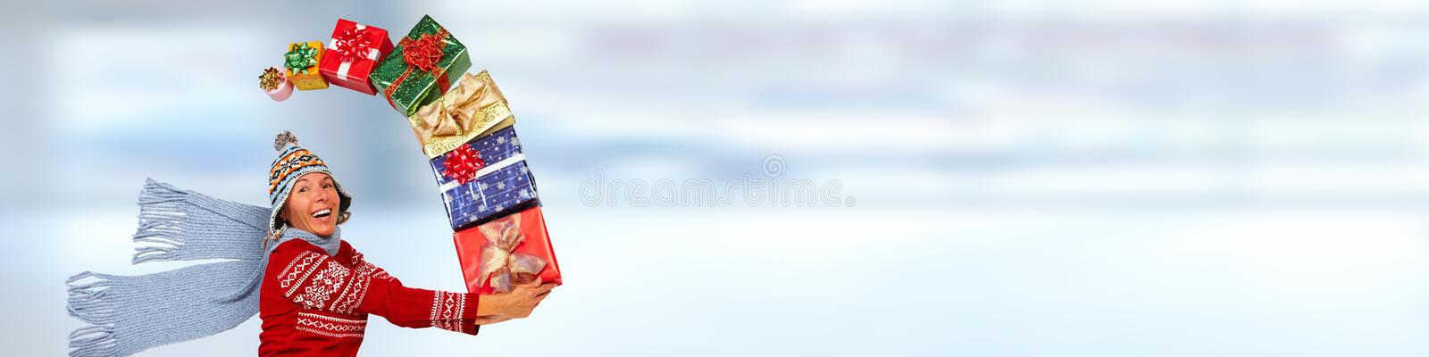 Happy woman with gifts. Happy caucasian girl running with Xmas gifts stock photography