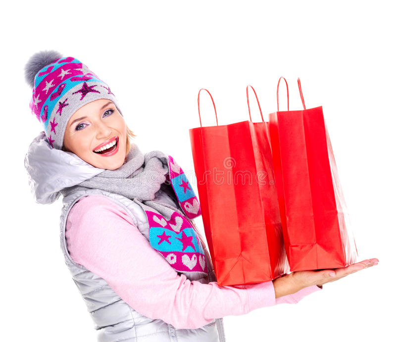Happy woman with gifts after shopping to the new year. Happy white woman with gifts after shopping to the new year stock photos