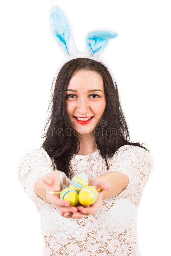 Happy woman give Easter eggs stock photos