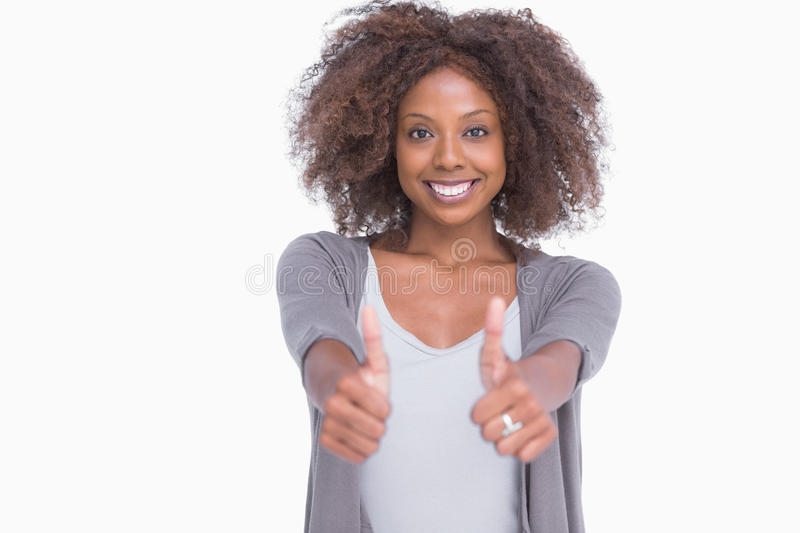 Happy woman giving thumbs up royalty free stock photo