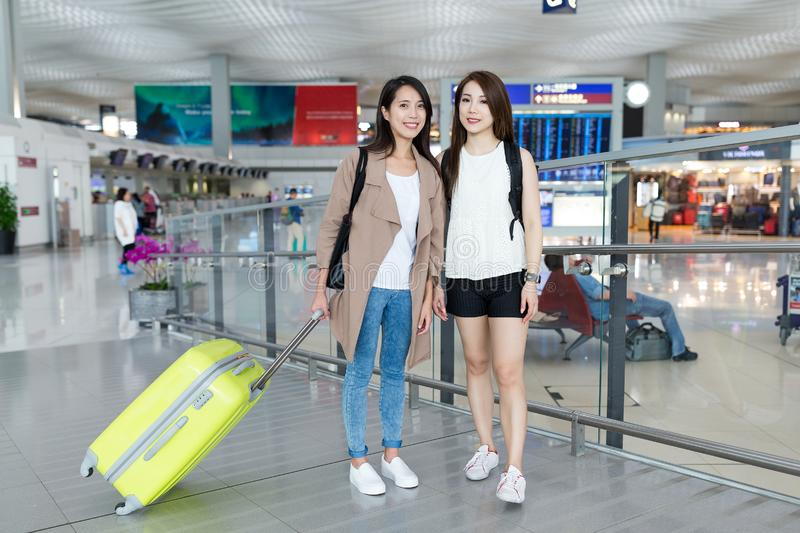 Happy woman go travel together in Hong Kong airport. Happy women go travel together in Hong Kong airport ,beautiful young asian woman stock photos