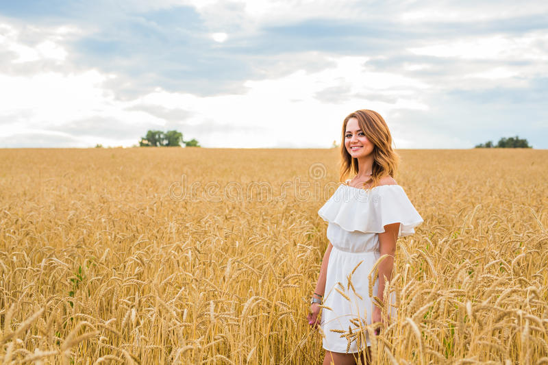 Download Happy Woman In Golden Wheat Stock Photo - Image of concept, lifestyle: 76249560