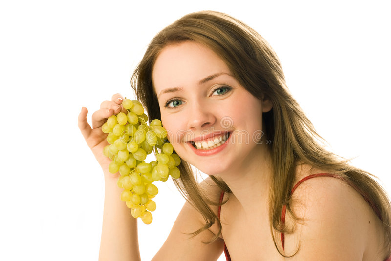 Happy woman with grapes royalty free stock image