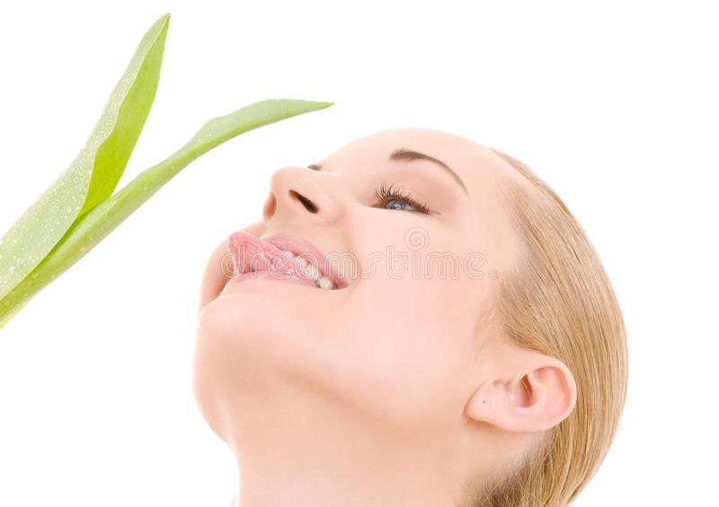 Happy woman with green leaf royalty free stock images