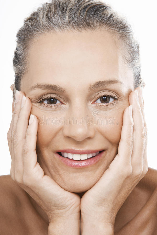 Happy Woman With Hands On Face royalty free stock photography