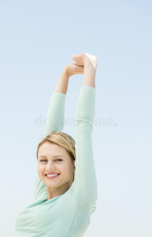 Download Happy Woman With Hands Raised Against Clear Sky Stock Image - Image: 32429799