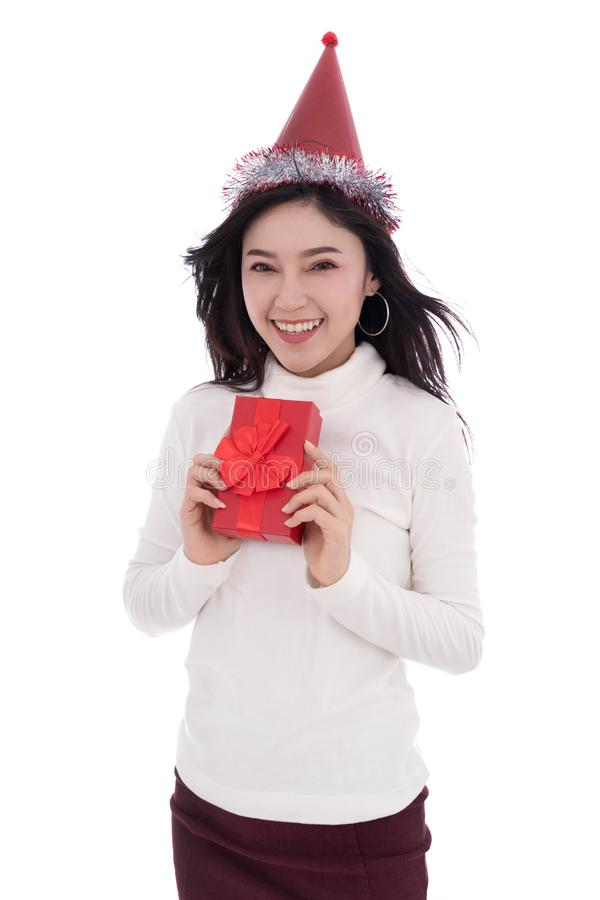 happy woman with hat and holding a red christmas gift box isolated on a white background stock photo