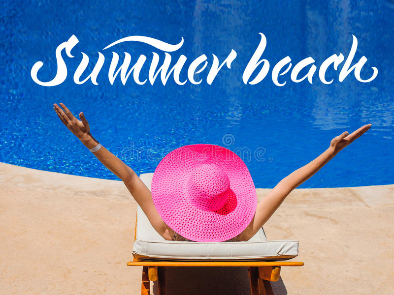 Happy woman with hat sunbathing on a sun lounger by the pool and words Summer beach.  stock photos