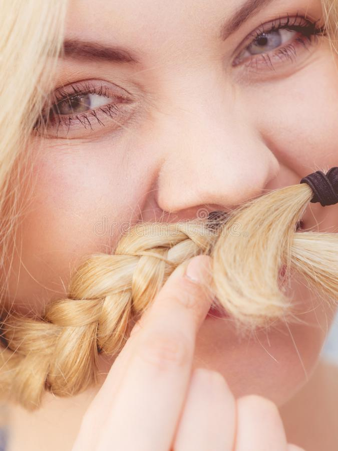 Happy woman having braided blonde hair royalty free stock photos
