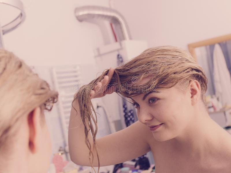 Woman with wet blonde hair stock photos