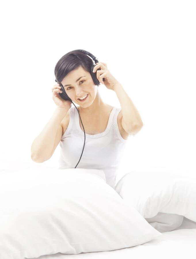 Happy woman with headphones stock image