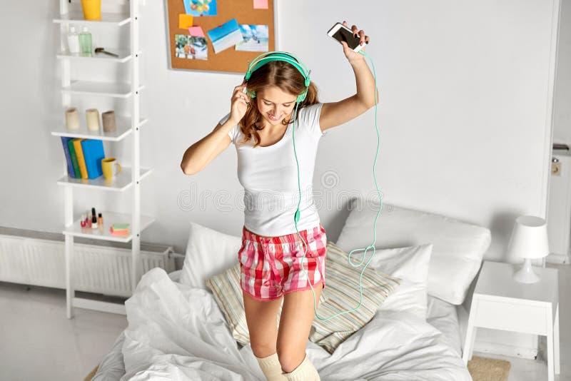 Happy woman in headphones having fun at home royalty free stock photos