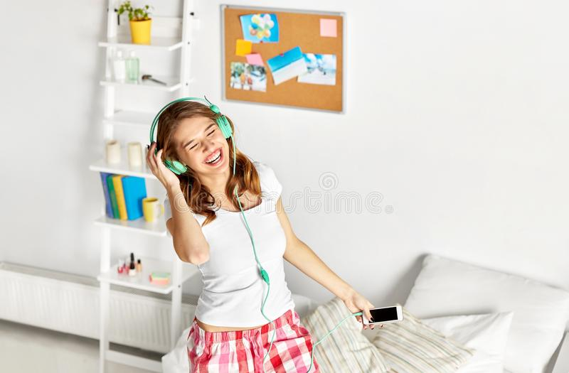 Happy woman in headphones having fun at home royalty free stock photography