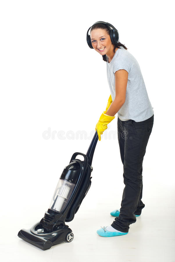 Happy woman with headphones and vacuum stock photo