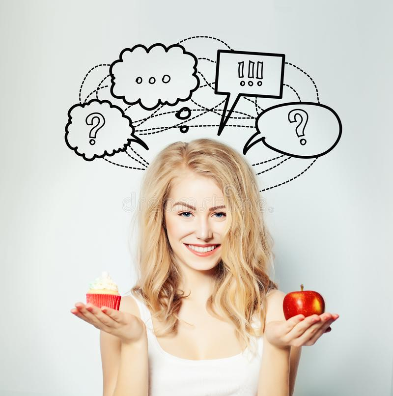 Happy Woman with Healthy and Unhealthy Food stock photos