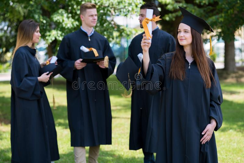 Happy woman on her graduation day University. Education and people. Friends class and classmates stock image