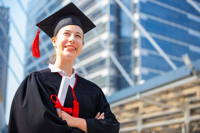 Happy woman on her graduation day University. Education and people. Academic, achievement, african, air, bachelor, background, black, board, campus, cap royalty free stock photo
