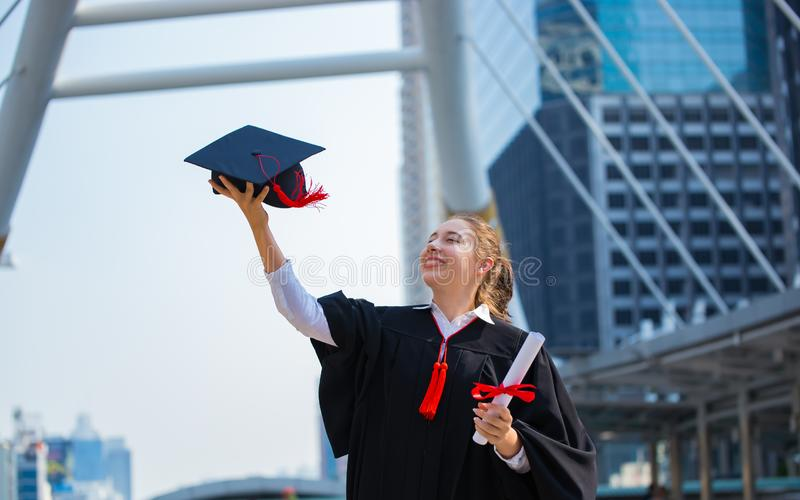 Happy woman on her graduation day University. Education and people. Academic, achievement, african, air, bachelor, background, black, board, campus, cap royalty free stock photography