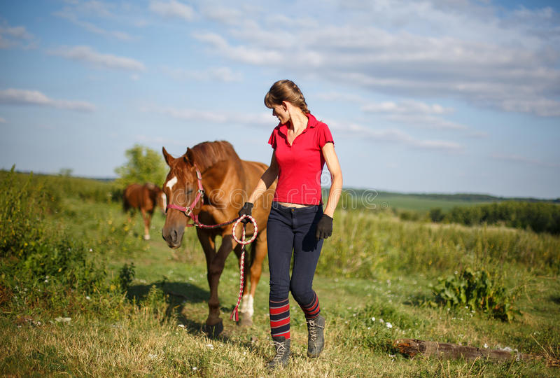 Happy Woman with her Horse - Beautiful young horsewoman. Next to her horse. equestrian stock photos