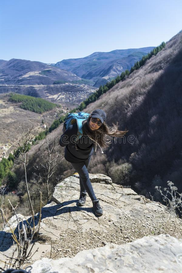 Happy Woman in a High Mountain. Happy woman relaxing in a high mountain royalty free stock images