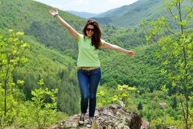 Happy Woman in a High Mountain royalty free stock image