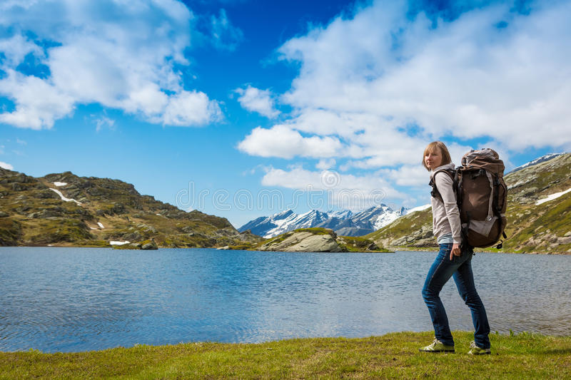 Happy Woman hiking in the mountains stock photo