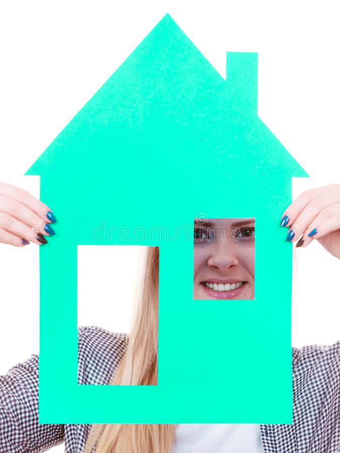 Happy woman holding blue paper house royalty free stock photography