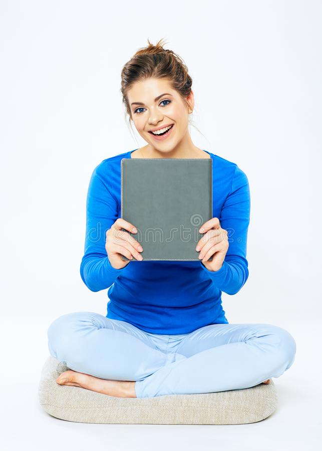 Happy woman holding book . Smiling girl sitting pose isolated o. N white background. Casual stule portrait stock photos