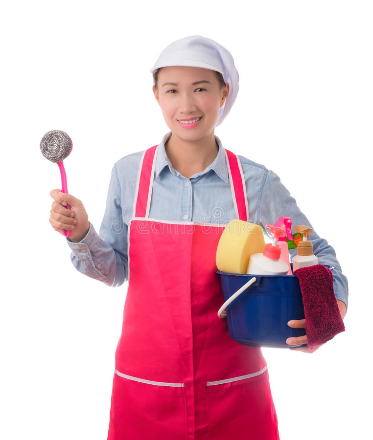 Happy woman holding a bucket full of cleaning supplies isolated stock image