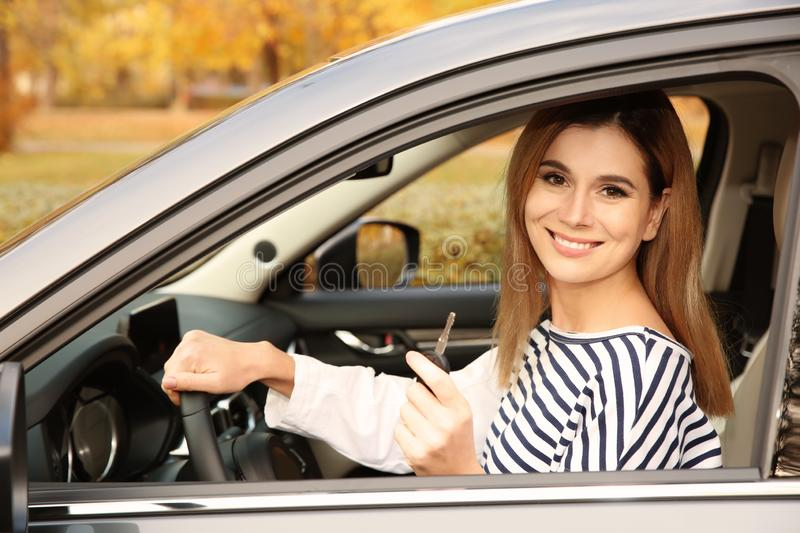Happy woman holding car key in auto. Driving test. Happy woman holding car key in auto. Driving license test stock images